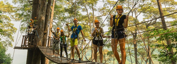 group of people posing at jungle flight sky bridge