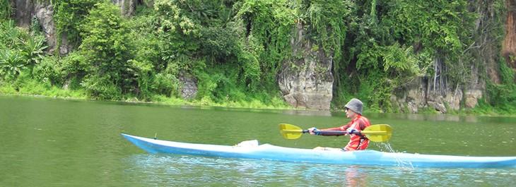 young man kayaking through a lake