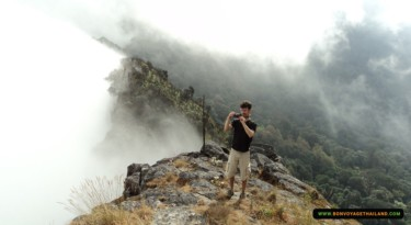 man taking photos on top of doi inthanon national park