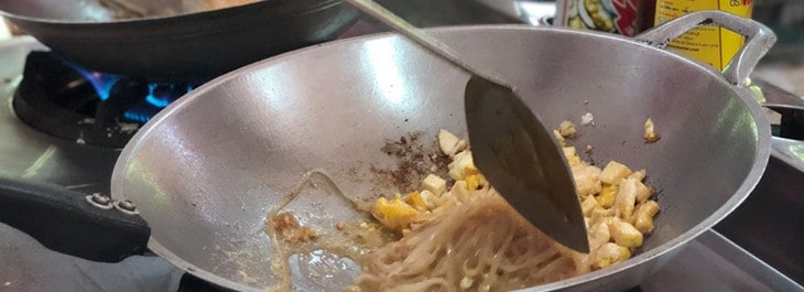 close up of pad thai cooking in wok