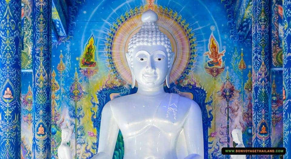 buddha statue inside blue temple wat rong seua ten