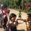 hill tribe children selling souvenirs in street