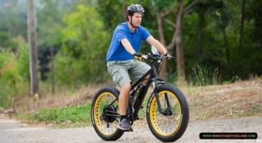 man riding on e-bike on hill