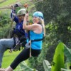 couple ziplining together over rice filed