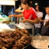 people buying food from local street food stall