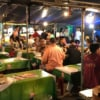 people eating at local street food market