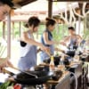 group of people cooking thai food at cooking station