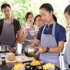 group of people learning to prepare mango and sticky rice