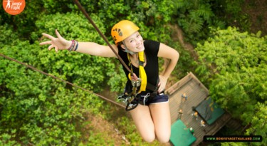 smiling woman descending from treetop