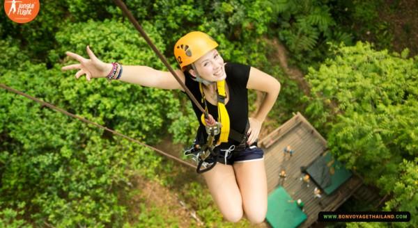 woman ziplining at jungle flight