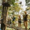 group of people posing at jungle flight sky bridge