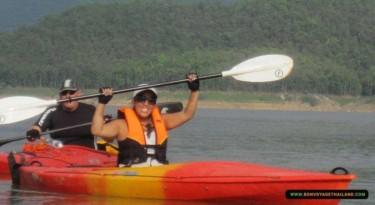 couple kayaking through a lake