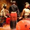 thai classical dance performance with umbrellas