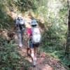 couple trekking through mae kampong