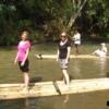group of people bamboo rafting along mae wang river