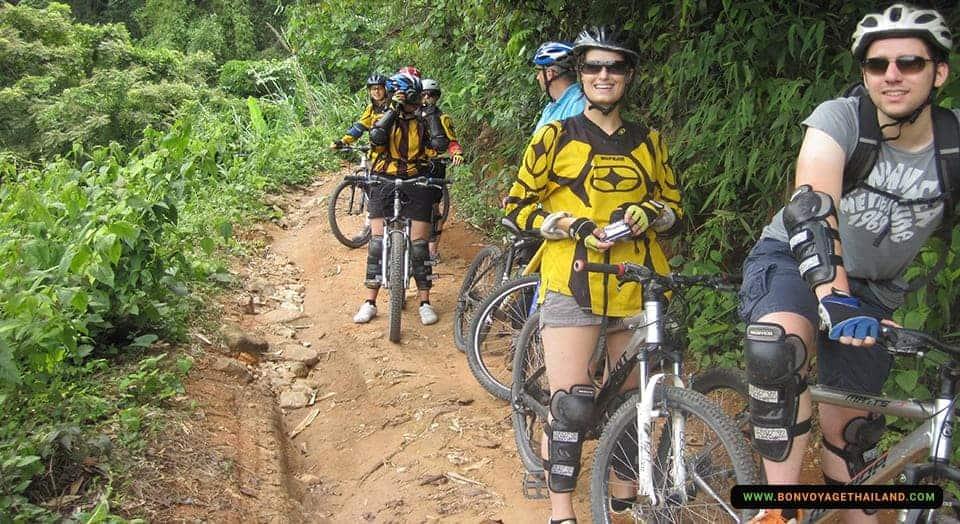 group of people biking through mountain