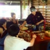 group of people learning authentic thai cooking