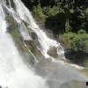 cascading waterfall with rainbow