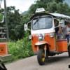 a convoy of tuk-tuks in Thai countryside