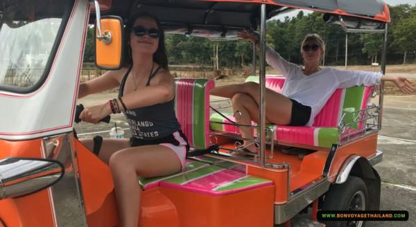 young women driving a tuk-tuk