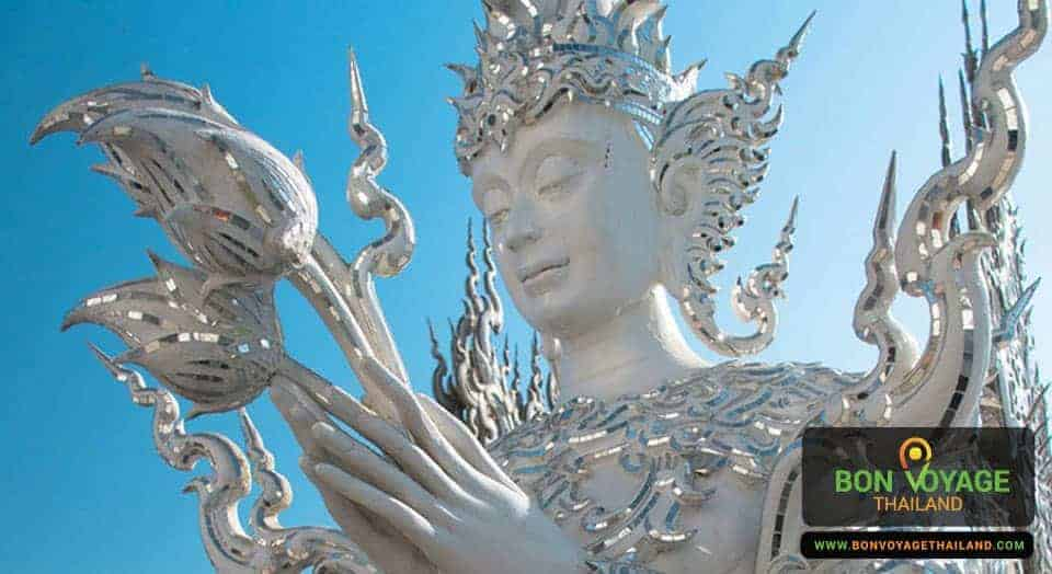 close up of buddha statue at white temple (wat rong khun) in chiang rai