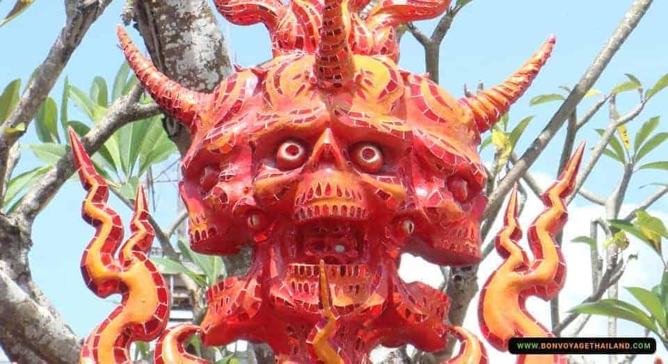 demon statue at white temple (wat rong khun) in chiang rai