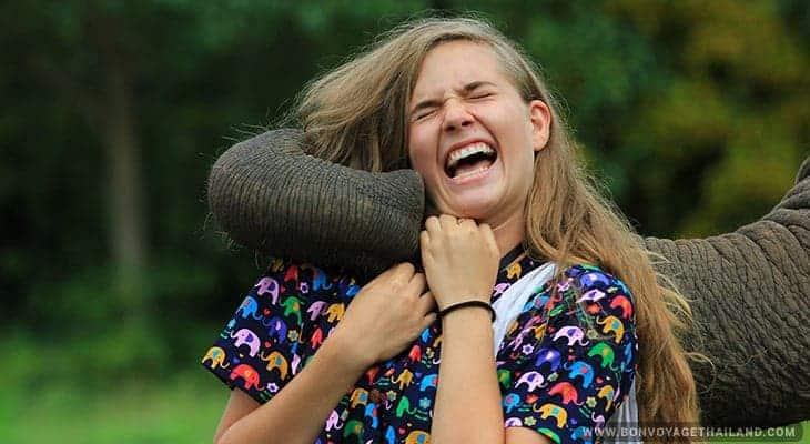 young woman bonding with elephant at knata elephant sanctuary