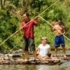 traditional bamboo rafting along river
