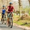 cycling along the road at lisu lodge