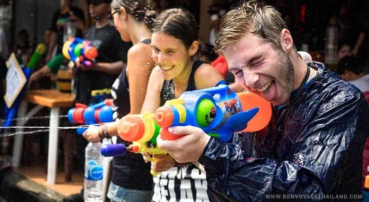 water gun fighting during songkran festival in chiang mai