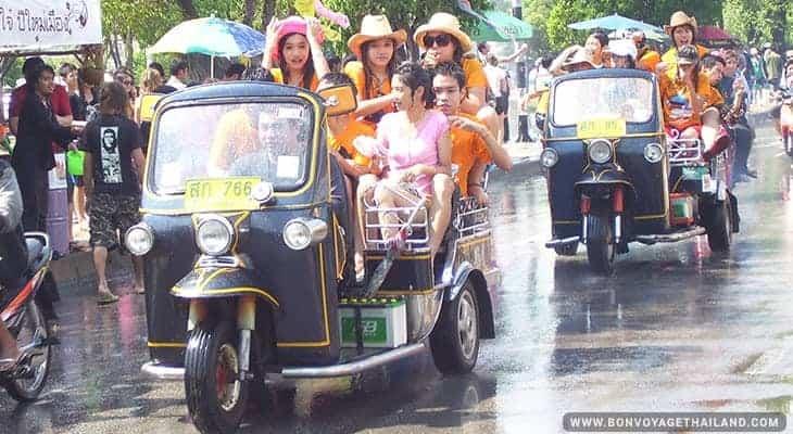 people in tuk tuks during songkran festival in chiang mai