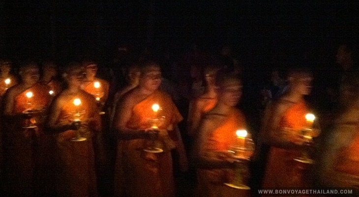 monks holding candles during yeepeng festival
