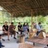 group of people learning about tea at araksa tea garden