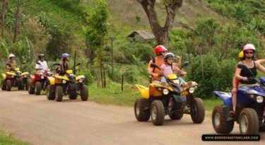 kids and adults enjoying riding atv through nature