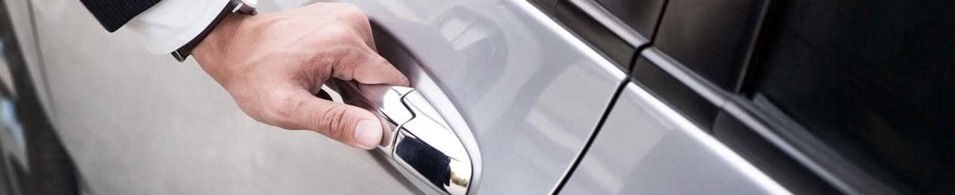 taxi driver opening car door