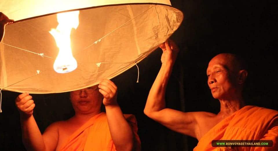 Monks floating a lantern