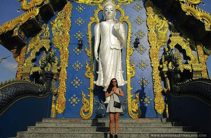 Women posing with Standing Buddha at the Blue Temple